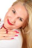 Face loura da mulher com pregos Fotografia de Stock Royalty Free