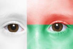 Face with madagascar flag. Human`s face with madagascar flag Stock Photo