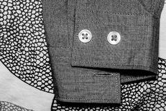 Face made of buttos and eyelet. Details of a button down shirt royalty free stock image