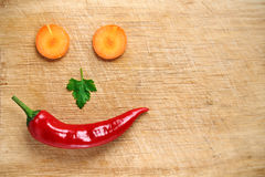 Face made of pepper, carrot and parsley Royalty Free Stock Image
