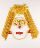 Face made with  raw pasta Stock Image