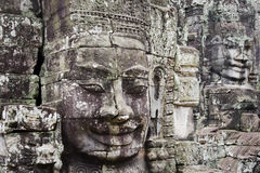 Face made of stone in angkor in cambodia Stock Photos
