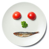 Face maked with vegetable and sprat Stock Photography
