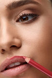 Face Makeup. Beautiful Woman Using Lip Pen, Pencil For Lips Stock Images