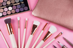 Face makeup brushes on pink and brown. Royalty Free Stock Images