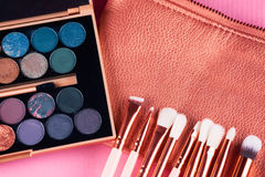 Face makeup brushes on pink and brown background. Royalty Free Stock Photography