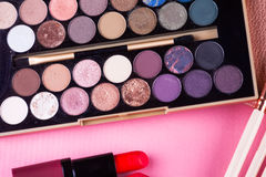 Face makeup brushes on pink and brown background. Stock Photos