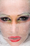 Face makeup veiled with gauze Stock Images
