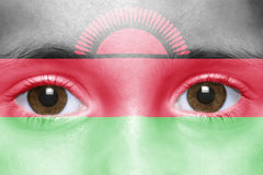 Face with malawi flag. Human`s face with malawi flag Stock Photo