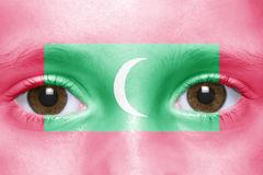 Face with maldives flag Stock Photo