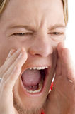 Face of male shouting loudly Stock Photo