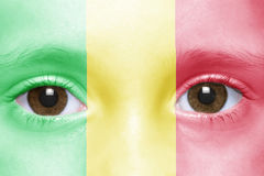 Face with malian flag. Human`s face with malian flag royalty free stock images