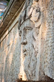 Face of a man with  beard carved in stone Stock Image