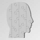 The face of a man consisting of a puzzle. Vector illustration of a logical task Royalty Free Stock Photo