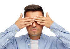 Face of man covering his eyes with hands Stock Image