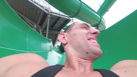 Face of a man descending from extreme water slides. First person view. Thailand. Face of a man descending from extreme water slides. First-person view pov. Aqua stock video footage