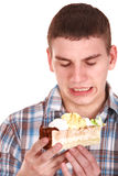 Face of man eating cake. Royalty Free Stock Image