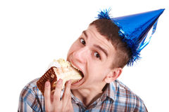 Face of man eating cake. Royalty Free Stock Images