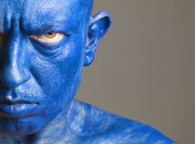 Face man painted of blue color Royalty Free Stock Images