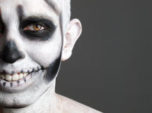 Face man painted with a skull 3 stock images