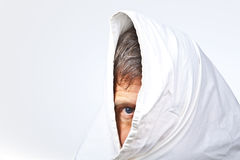 Face of man partially covered Stock Image