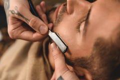 Face of man shaving Stock Photos