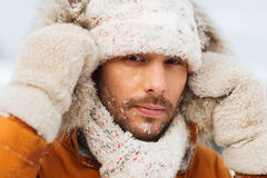 Face of man in winter clothes outdoors Royalty Free Stock Photo