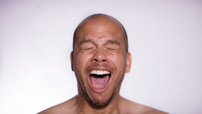 Face of a man yawning with his mouth wide open Royalty Free Stock Images