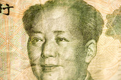 Face of Mao, leader of China on a banknote of Chinese Yuan, as a symbol of the modern economy Royalty Free Stock Photography