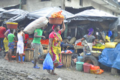 FACE OF A MARKET IN IVORY COAST AFTER THE PASSAGE OF A SWING RAIN Royalty Free Stock Image