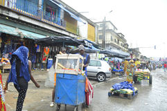 FACE OF A MARKET IN IVORY COAST AFTER THE PASSAGE OF A SWING RAIN Stock Images