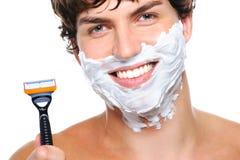 Face masculina feliz com a lâmina sobre o branco fotos de stock royalty free
