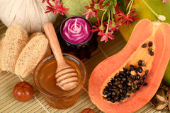 Face mask for acne treatment with Papaya and honey. Stock Photography