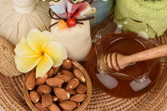 Face mask with almonds and honey. royalty free stock photos