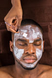 Face Mask Applied To Young Man Royalty Free Stock Images
