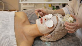 Face mask being applied during spa treatment stock video