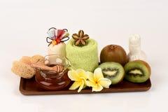 Face mask with Kiwi fruit and honey. Stock Photos