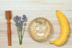 Face mask from oatmeal, yogurt, banana and honey royalty free stock photography