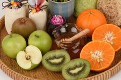 Face mask with orange, kiwi, apples and honey. Stock Image