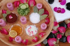 Face Masks. Bath salt, body scrubs, petals, orchids, towels, and pebbles in a spa Royalty Free Stock Images