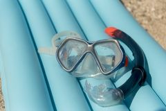 Face masks and snorkels sea on air mattress. Inflate bed. Summer fan for joining Royalty Free Stock Photography