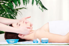 Face massage. Girl on face massage in salon Royalty Free Stock Image