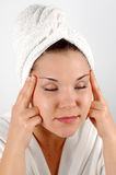 Face massage #6. Attractive woman with towel on white background Stock Photo