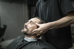 Face massage in barbershop Stock Images