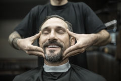Face massage in barbershop Stock Photography