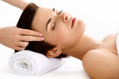 Face Massage. Beautiful Woman Getting Treatment in Spa Salon Stock Image