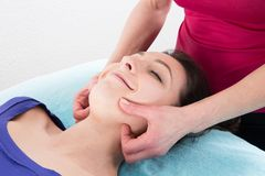 Face massage of a beautiful woman at the wellness center. And spa stock image