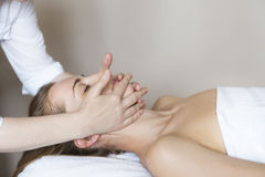 Face massage or beauty treatment in spa salon Royalty Free Stock Image
