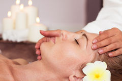 Face Massage. Close-up of a beautiful Woman Getting Spa Treatment. royalty free stock images