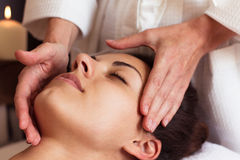 Face Massage. Close-up of a beautiful Woman Getting Spa Treatmen Stock Photo